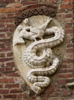 This coat of arms (a viper eating lunch) is the official symbol of Milan, as well as of Alfa-Romeo, which is based in Milan.