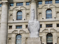 This controversial sculpture stand in front of Milan's stock exchange. It's official name is L.O.V.E which, when translated from Italian, stands for Freedom, Hate, Vengeance, Eternity.